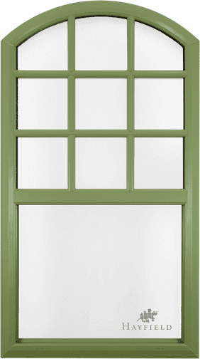 Beautyifully rounded green, wood-textured trim specialty window with rounded top and grid